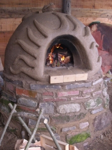 Love the earthy and organic feel of these earth oven structures.